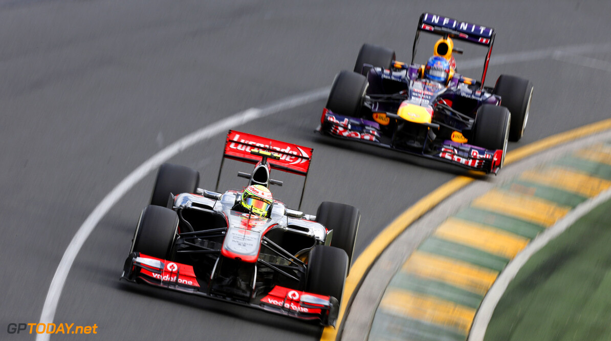 Sergio Perez leads Sebastian Vettel of Red Bull Racing
