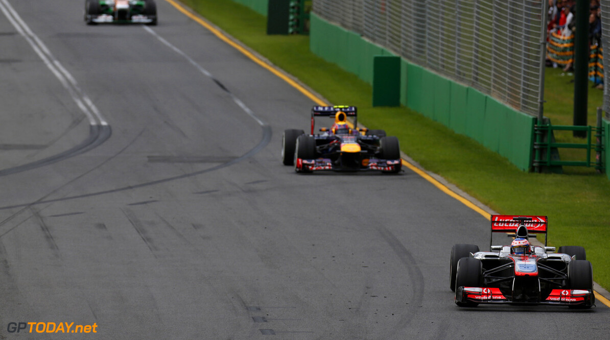 Jenson Button leads Mark Webber of Red Bull Racing