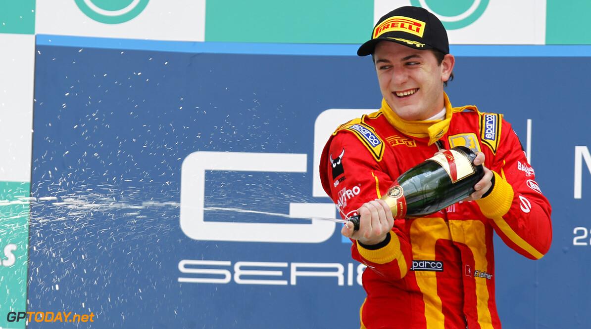 2013 GP2 Series. Round 1.  Sepang, Kuala Lumpur, Malaysia. 23rd March 2013.  Saturday Race.  Fabio Leimer (SUI, Racing Engineering) celebrates his victory on the podium.  World Copyright: Alastair Staley/GP2 Series Media Service.  ref: _A8C5894