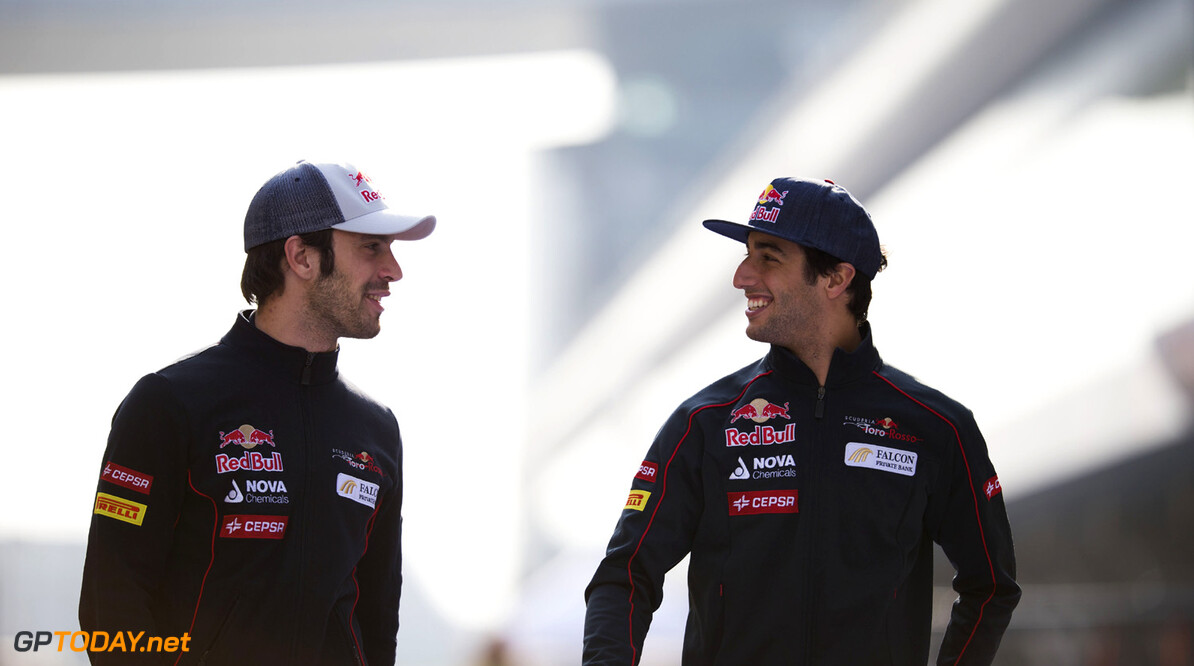 163375729KR00060_F1_Grand_P SHANGHAI, CHINA - APRIL 11:  (L-R) Jean-Eric Vergne of France and Scuderia Toro Rosso and team mate Daniel Ricciardo of Australia and Scuderia Toro Rosso walk in the pitlane during previews to the Chinese Formula One Grand Prix at the Shanghai International Circuit on April 11, 2013 in Shanghai, China.  (Photo by Peter Fox/Getty Images) *** Local Caption *** Jean-Eric Vergne; Daniel Ricciardo F1 Grand Prix of China - Previews Peter Fox Shanghai China  Formula One Racing formula 1 Auto Racing Formula 1 Grand Prix of China Chinese Formula One Grand Prix Formula One Grand Prix