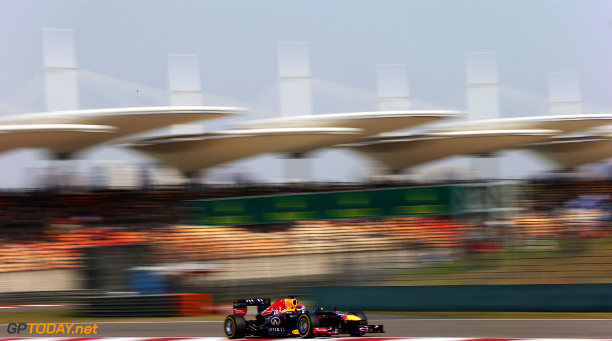 163375755KR00125_F1_Grand_P SHANGHAI, CHINA - APRIL 13:  Sebastian Vettel of Germany and Infiniti Red Bull Racing drives during qualifying for the Chinese Formula One Grand Prix at the Shanghai International Circuit on April 13, 2013 in Shanghai, China.  (Photo by Mark Thompson/Getty Images) *** Local Caption *** Sebastian Vettel F1 Grand Prix of China - Qualifying Mark Thompson Shanghai China  Formula One Racing formula 1 Auto Racing Formula 1 Grand Prix of China Chinese Formula One Grand Prix Formula One Grand Prix