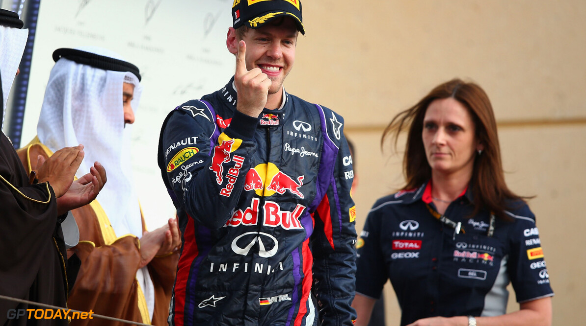 163377134KR00125_F1_Grand_P SAKHIR, BAHRAIN - APRIL 21:  Sebastian Vettel of Germany and Infiniti Red Bull Racing celebrates on the podium after winning the Bahrain Formula One Grand Prix at the Bahrain International Circuit on April 21, 2013 in Sakhir, Bahrain.  (Photo by Clive Mason/Getty Images) *** Local Caption *** Sebastian Vettel F1 Grand Prix of Bahrain - Race Clive Mason Sakhir Bahrain  formula 1 Formula One Racing Auto Racing Formula 1 Grand Prix of Bahrain Bahrain Formula One Grand Prix Formula One Grand Prix