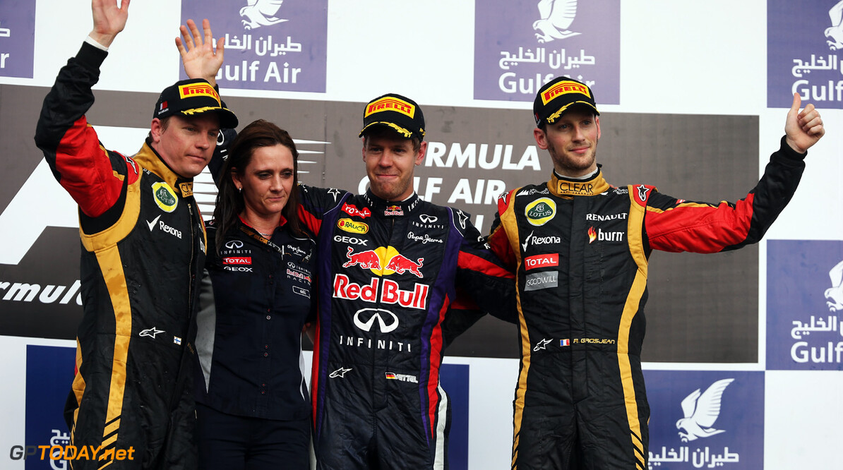 163377134KR00111_F1_Grand_P SAKHIR, BAHRAIN - APRIL 21:  Race winner Sebastian Vettel (2nd right) of Germany and Infiniti Red Bull Racing celebrates with Gill Jones (2nd left) the Infiniti Red Bull Racing Electronic Support Group Leader, second placed Kimi Raikkonen (left) of Finland and Lotus and third placed Romain Grosjean (right) of France and Lotus following the Bahrain Formula One Grand Prix at the Bahrain International Circuit on April 21, 2013 in Sakhir, Bahrain.  (Photo by Mark Thompson/Getty Images) *** Local Caption *** Gill Jones; Sebastian Vettel; Kimi Raikkonen; Romain Grosjean F1 Grand Prix of Bahrain - Race Mark Thompson Sakhir Bahrain  formula 1 Formula One Racing Auto Racing Formula 1 Grand Prix of Bahrain Bahrain Formula One Grand Prix Formula One Grand Prix