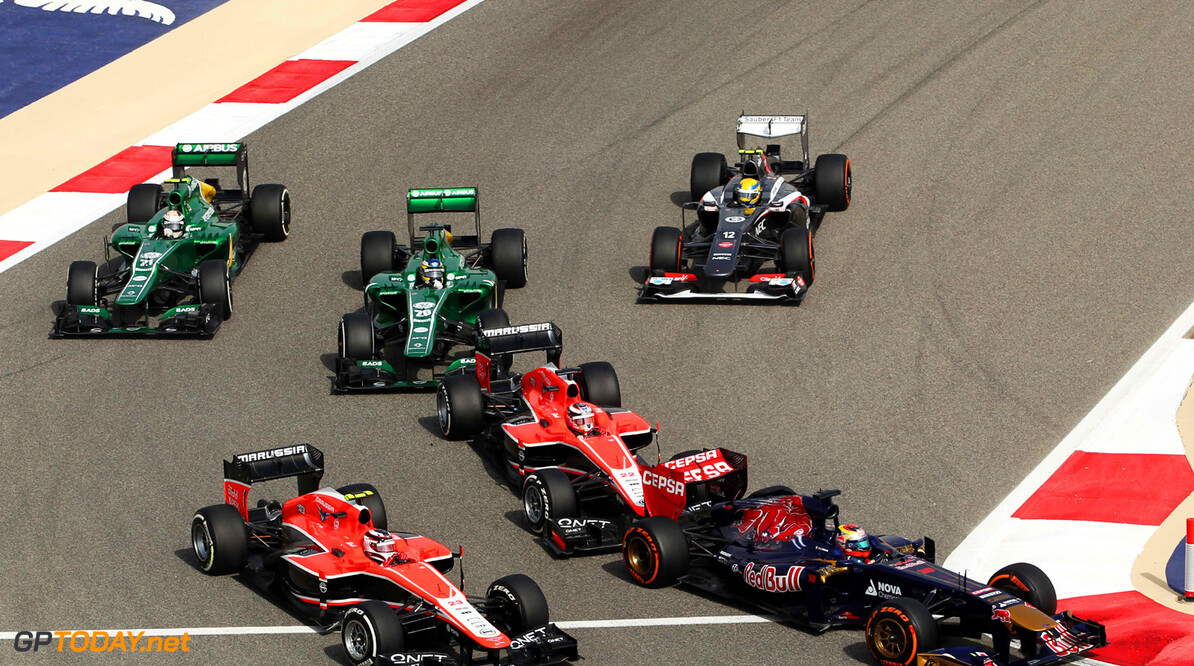 Formula One World Championship Max Chilton (GBR) Marussia F1 Team MR02 and Jules Bianchi (FRA) Marussia F1 Team MR02 behind Jean-Eric Vergne (FRA) Scuderia Toro Rosso STR8 at the start of the race.