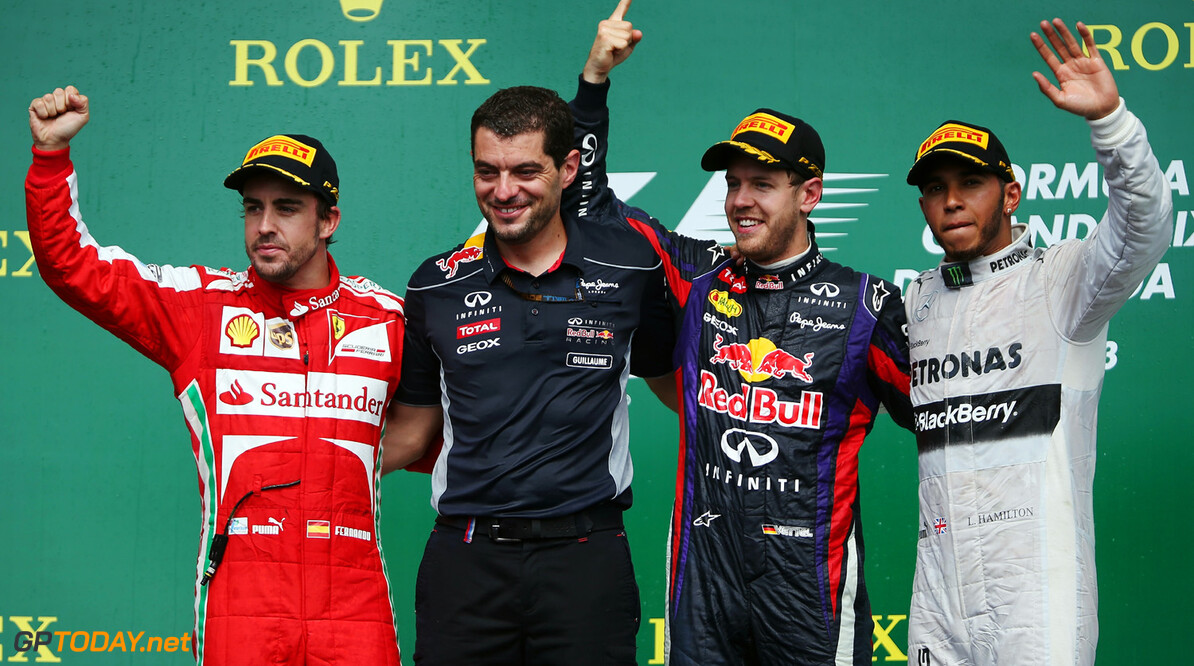 163377382KR00081_Canadian_F MONTREAL, QC - JUNE 09:  Sebastian Vettel (2nd right) of Germany and Infiniti Red Bull Racing celebrates with his race engineer Guillaume Rocquelin (2nd left), second placed Fernando Alonso (left) of Spain and Ferrari and third placed Lewis Hamilton (right) of Great Britain and Mercedes GP following the Canadian Formula One Grand Prix at the Circuit Gilles Villeneuve on June 9, 2013 in Montreal, Canada.  (Photo by Mark Thompson/Getty Images) *** Local Caption *** Sebastian Vettel; Guillaume Rocquelin; Fernando Alonso; Lewis Hamilton Canadian F1 Grand Prix - Race Mark Thompson Montreal Canada  Formula One Racing formula 1 Auto Racing Formula 1 Canadian Grand Prix Canadian Formula One Grand Prix Formula One Grand Prix