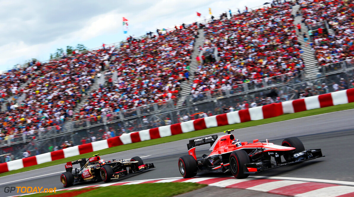 Formula One World Championship Max Chilton (GBR) Marussia F1 Team MR02 leads Romain Grosjean (FRA) Lotus F1 E21.
