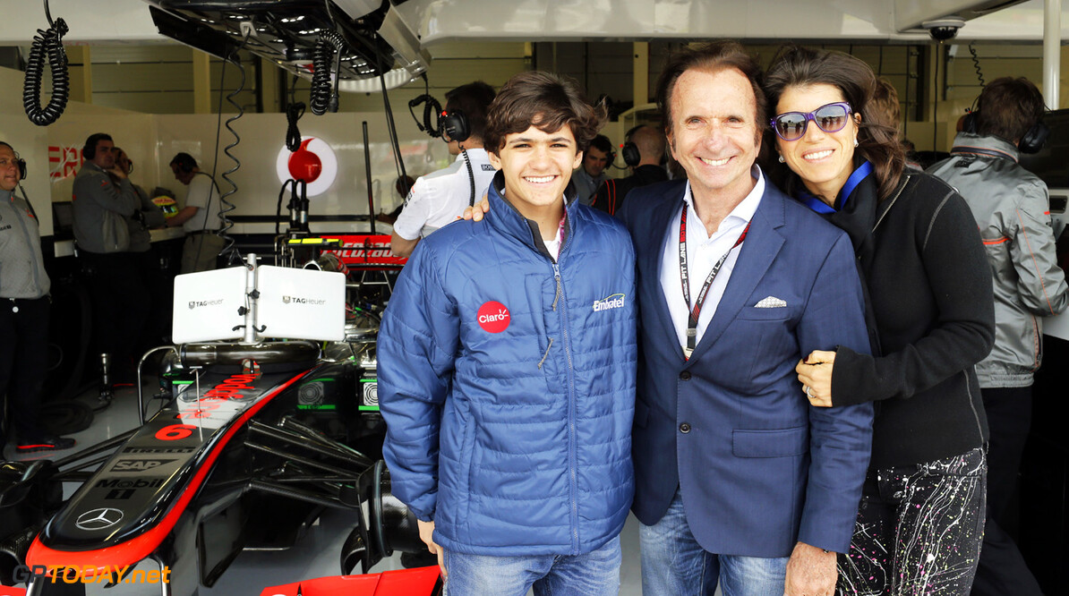 Former World Champion Emerson Fittipaldi visits the garage with his grandson Pietro