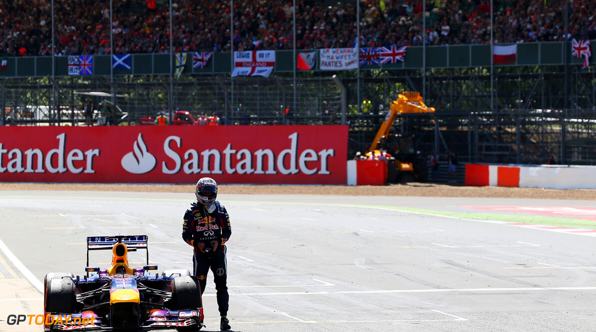 163377786KR00024_F1_Grand_P NORTHAMPTON, ENGLAND - JUNE 30:  Sebastian Vettel of Germany and Infiniti Red Bull Racing retires on the main straight with an engine failure during the British Formula One Grand Prix at Silverstone Circuit on June 30, 2013 in Northampton, England.  (Photo by Mark Thompson/Getty Images) *** Local Caption *** Sebastian Vettel F1 Grand Prix of Great Britain - Race Mark Thompson Northampton United Kingdom  Formula One Racing formula 1 Auto Racing Formula 1 Grand Prix of Great B British Formula One Grand Prix Formula One Grand Prix