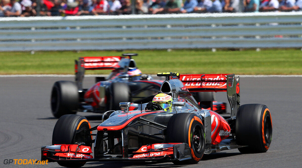 Sergio Perez leads Jenson button on track