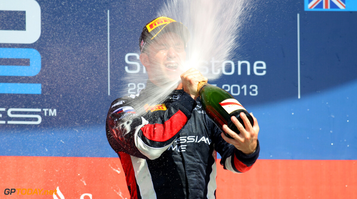 2013 GP2 Series. Round 5. Silverstone, Northamptonshire, England. 29th June. Saturday Race. Sam Bird (GBR, RUSSIAN TIME) celebrates his victory on the podium.  World Copyright: Malcolm Griffiths/GP2 Series Media Service. Ref: C76D1128