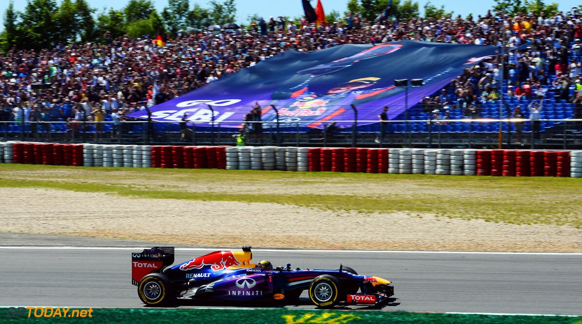 166985819KR00044_F1_Grand_P NUERBURG, GERMANY - JULY 07:  Sebastian Vettel of Germany and Infiniti Red Bull Racing drives past a giant banner supporting him during the German Grand Prix at the Nuerburgring on July 7, 2013 in Nuerburg, Germany.  (Photo by Lars Baron/Getty Images) *** Local Caption *** Sebastian Vettel F1 Grand Prix of Germany - Race Lars Baron Nuerburg Germany  Nurburg Nurburgring