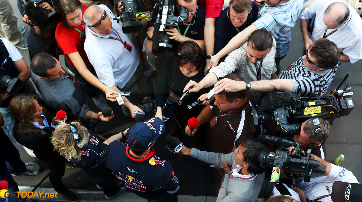 166985664KR00088_F1_Grand_P NUERBURG, GERMANY - JULY 04:  Mark Webber of Australia and Infiniti Red Bull Racing is interviewed by the media during previews to the German Grand Prix at the Nuerburgring on July 4, 2013 in Nuerburg, Germany.  (Photo by Mark Thompson/Getty Images) *** Local Caption *** Mark Webber F1 Grand Prix of Germany - Previews Mark Thompson Nuerburg Germany  Nurburg Nurburgring