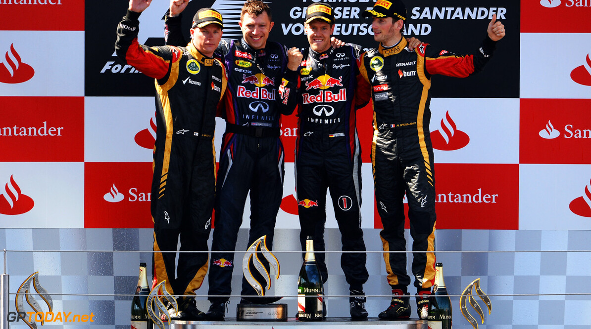166985819KR00104_F1_Grand_P NUERBURG, GERMANY - JULY 07:  Race winner Sebastian Vettel (2nd right) of Germany and Infiniti Red Bull Racing celebrates on the podium with second placed Kimi Raikkonen (left) of Finland and Lotus, third placed Romain Grosjean (right) of France and Lotus and his number one mechanic Joe Robinson following the German Grand Prix at the Nuerburgring on July 7, 2013 in Nuerburg, Germany.  (Photo by Lars Baron/Getty Images) *** Local Caption *** Sebastian Vettel; Kimi Raikkonen; Romain Grosjean; Joe Robinson F1 Grand Prix of Germany - Race Lars Baron Nuerburg Germany  Nurburg Nurburgring