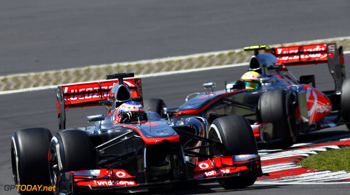 Jenson Button leads Sergio Perez