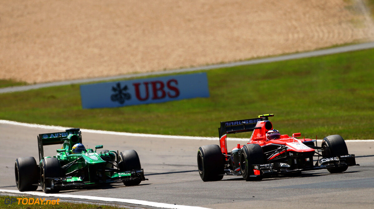 Formula One World Championship Max Chilton (GBR) Marussia F1 Team MR02 battles with Charles Pic (FRA) Caterham CT03.