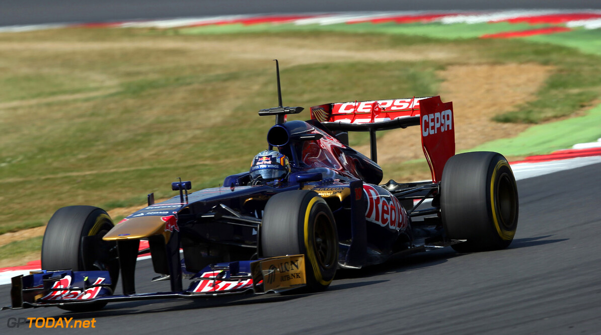 174042008MT00074_F1_YOUNG_D NORTHAMPTON, ENGLAND - JULY 18:   Carlos Sainz Jr of Spain driving for the Scuderia Toro Rosso team during the young drivers test at Silverstone Circuit on July 18, 2013 in Northampton, England.  (Photo by Mark Thompson/Getty Images) F1 Young Driver Tests - Silverstone: Day Two Mark Thompson Northampton United Kingdom  Formula One Racing