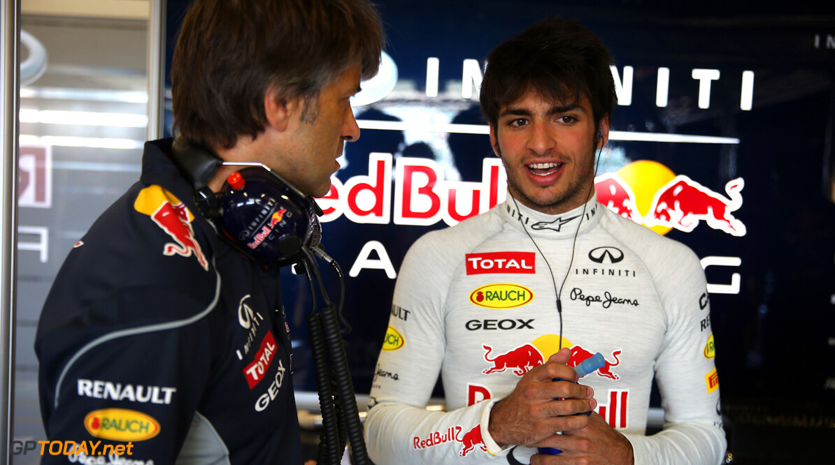 174042266MT00016_F1_YOUNG_D NORTHAMPTON, ENGLAND:    Carlos Sainz Jr of Spain talks with engineer Andy Deram as he prepares to drive the Infiniti Red Bull Racing car during the young drivers test at Silverstone Circuit on July 19, 2013 in Northampton, England.  (Photo by Mark Thompson/Getty Images) F1 Young Driver Tests - Silverstone: Day Three Mark Thompson Northampton United Kingdom  Formula One Racing