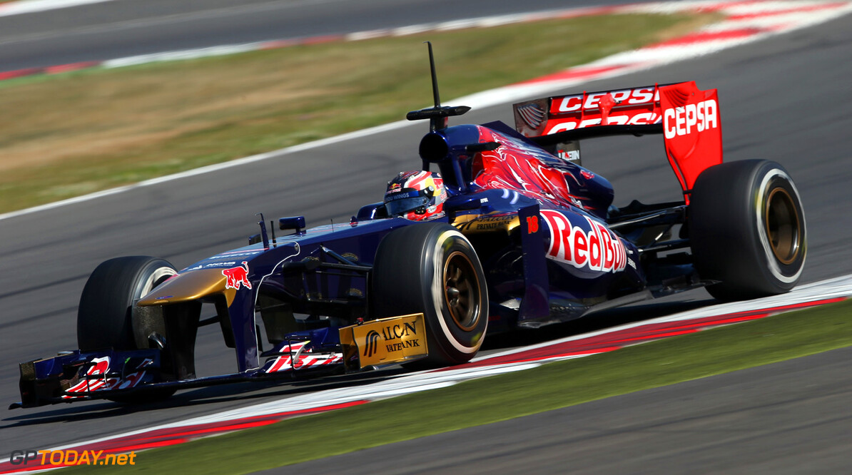 174042266MT00038_F1_Young_D NORTHAMPTON, ENGLAND, JULY 19:    Daniil Kvyat of Russia drives the Toro Rosso F1 car during the young drivers test at Silverstone Circuit on July 19, 2013 in Northampton, England.  (Photo by Mark Thompson/Getty Images) F1 Young Driver Tests - Silverstone: Day Three Mark Thompson Northampton United Kingdom  Formula One Racing