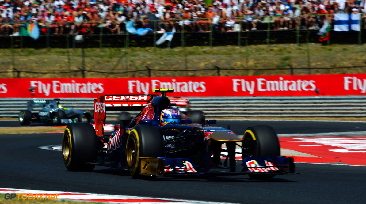 166986040KR00165_F1_Grand_P BUDAPEST, HUNGARY - JULY 28:  Daniel Ricciardo of Australia and Scuderia Toro Rosso drives during the Hungarian Formula One Grand Prix at Hungaroring on July 28, 2013 in Budapest, Hungary.  (Photo by Lars Baron/Getty Images) *** Local Caption *** Daniel Ricciardo F1 Grand Prix of Hungary - Race Lars Baron Budapest Hungary