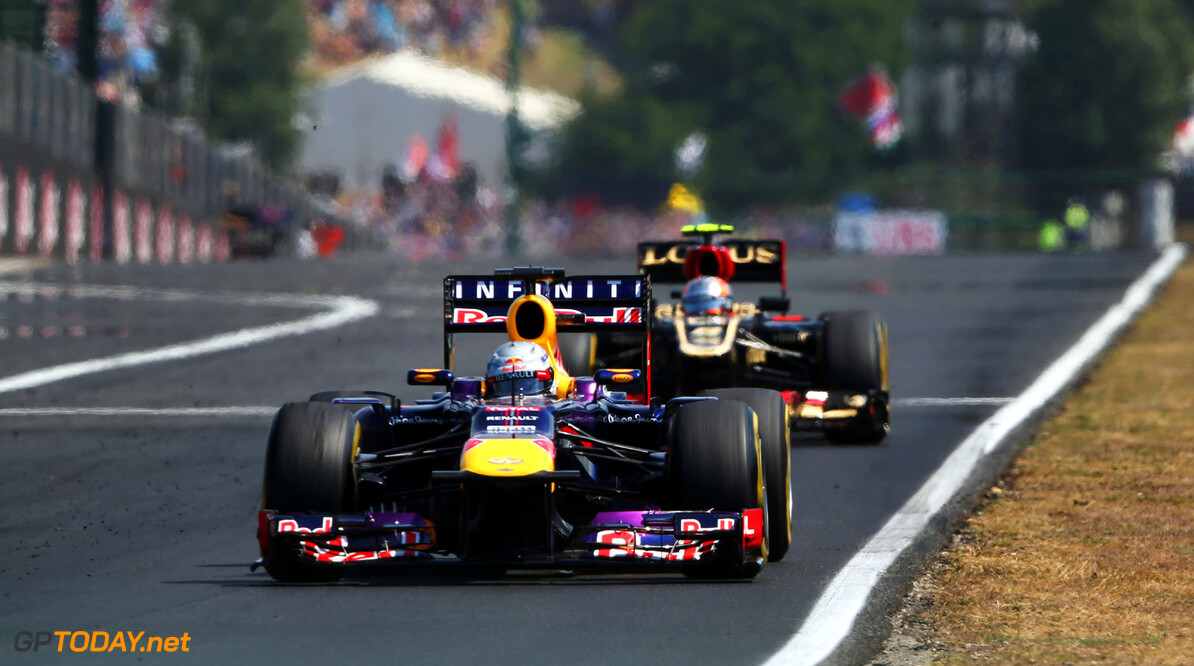 166986040KR00048_F1_Grand_P BUDAPEST, HUNGARY - JULY 28:  Sebastian Vettel of Germany and Infiniti Red Bull Racing leads from Romain Grosjean of France and Lotus during the Hungarian Formula One Grand Prix at Hungaroring on July 28, 2013 in Budapest, Hungary.  (Photo by Mark Thompson/Getty Images) *** Local Caption *** Sebastian Vettel; Romain Grosjean F1 Grand Prix of Hungary - Race Mark Thompson Budapest Hungary