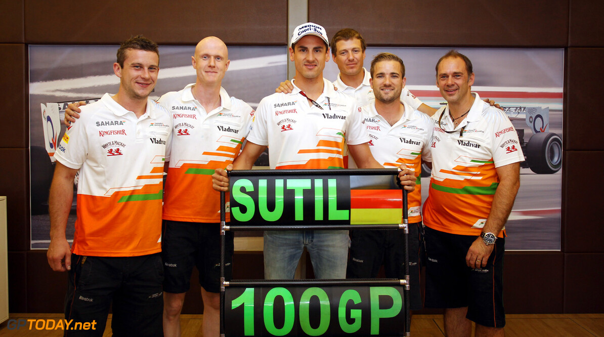 Formula One World Championship Adrian Sutil (GER) Sahara Force India F1 celebrates his 100th GP with his crew.  Hungarian Grand Prix, Sunday 28th July 2013. Budapest, Hungary. Motor Racing - Formula One World Championship - Hungarian Grand Prix - Race Day - Budapest, Hungary James Moy Photography Budapest Hungary  Formula One Formula 1 F1 GP Grand Prix Circuit Hungaroring Hungarian Budapest Hungary JM208 Portrait GP1310