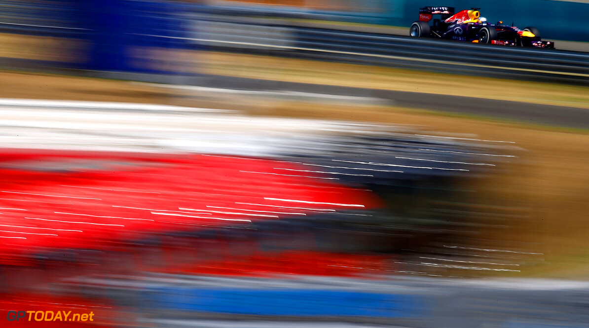 166985936VR016_F1_Grand_Pri BUDAPEST, HUNGARY - JULY 26: Sebastian Vettel of Germany and Infiniti Red Bull Racing drives   during practice for the Hungarian Formula One Grand Prix at Hungaroring on July 26, 2013 in Budapest, Hungary. *** Local Caption *** Sebastian Vettel F1 Grand Prix of Hungary - Practice Vladimir Rys Budapest Hungary