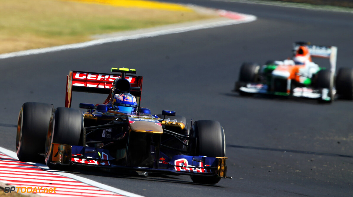 166986040KR00160_F1_Grand_P BUDAPEST, HUNGARY - JULY 28:  Daniel Ricciardo of Australia and Scuderia Toro Rosso drives during the Hungarian Formula One Grand Prix at Hungaroring on July 28, 2013 in Budapest, Hungary.  (Photo by Mark Thompson/Getty Images) *** Local Caption *** Daniel Ricciardo F1 Grand Prix of Hungary - Race Mark Thompson Budapest Hungary