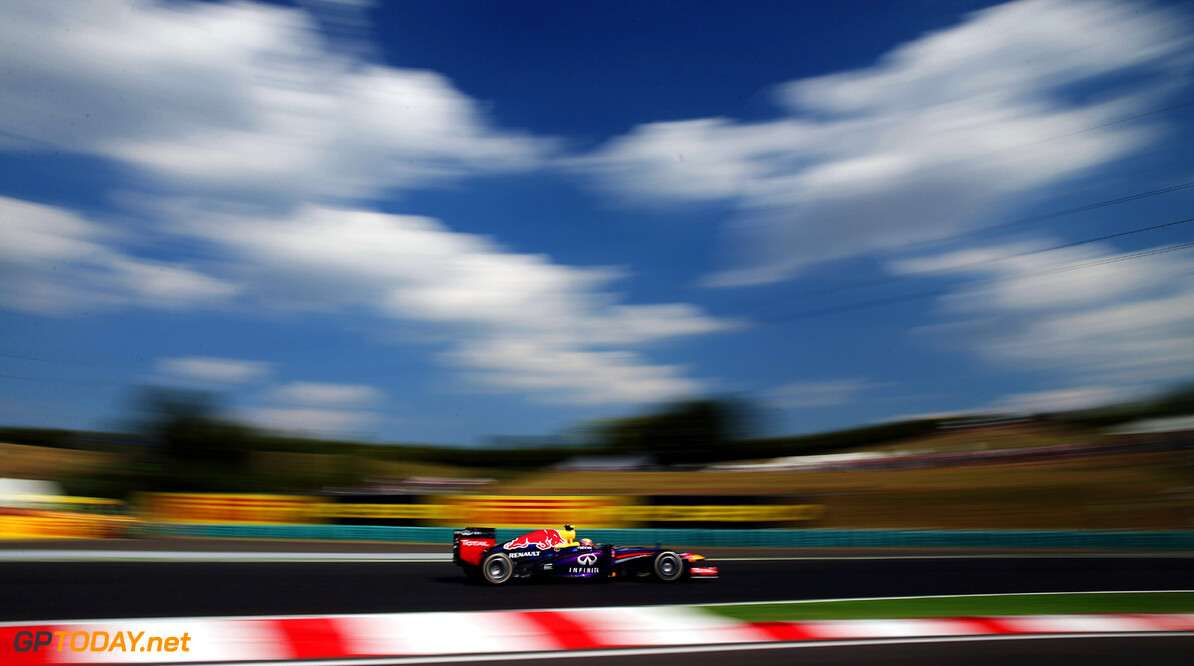 166985936KR00175_F1_Grand_P BUDAPEST, HUNGARY - JULY 26:  (EDITORS NOTE: A POLARIZING FILTER WAS USED IN THE CREATION OF THIS IMAGE) Mark Webber of Australia and Infiniti Red Bull Racing drives during practice for the Hungarian Formula One Grand Prix at Hungaroring on July 26, 2013 in Budapest, Hungary.  (Photo by Mark Thompson/Getty Images) *** Local Caption *** Mark Webber F1 Grand Prix of Hungary - Practice Mark Thompson Budapest Hungary