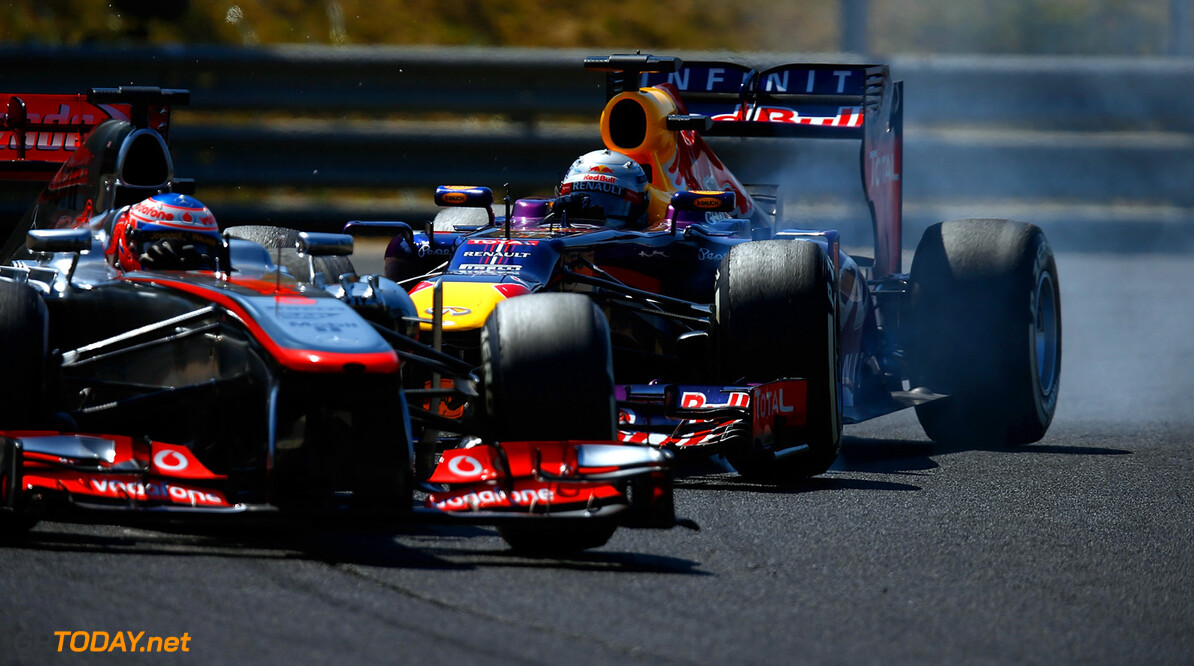 166986040VR015_F1_Grand_Pri BUDAPEST, HUNGARY - JULY 28:  Sebastian Vettel of Germany and Infiniti Red Bull Racing locks up behind Jenson Button of Great Britain and McLaren during the Hungarian Formula One Grand Prix at Hungaroring on July 28, 2013 in Budapest, Hungary.  (Photo by Vladimir Rys/Getty Images) *** Local Caption *** Jenson Button; Sebastian Vettel F1 Grand Prix of Hungary Vladimir Rys Budapest Hungary