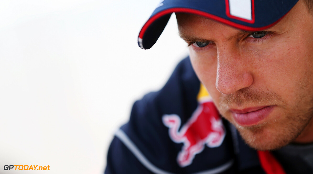 166985873KR00035_F1_Grand_P BUDAPEST, HUNGARY - JULY 25:  Sebastian Vettel of Germany and Infiniti Red Bull Racing is interviewed by the media during previews to the Hungarian Formula One Grand Prix at Hungaroring on July 25, 2013 in Budapest, Hungary.  (Photo by Mark Thompson/Getty Images) *** Local Caption *** Sebastian Vettel F1 Grand Prix of Hungary - Previews Mark Thompson Budapest Hungary