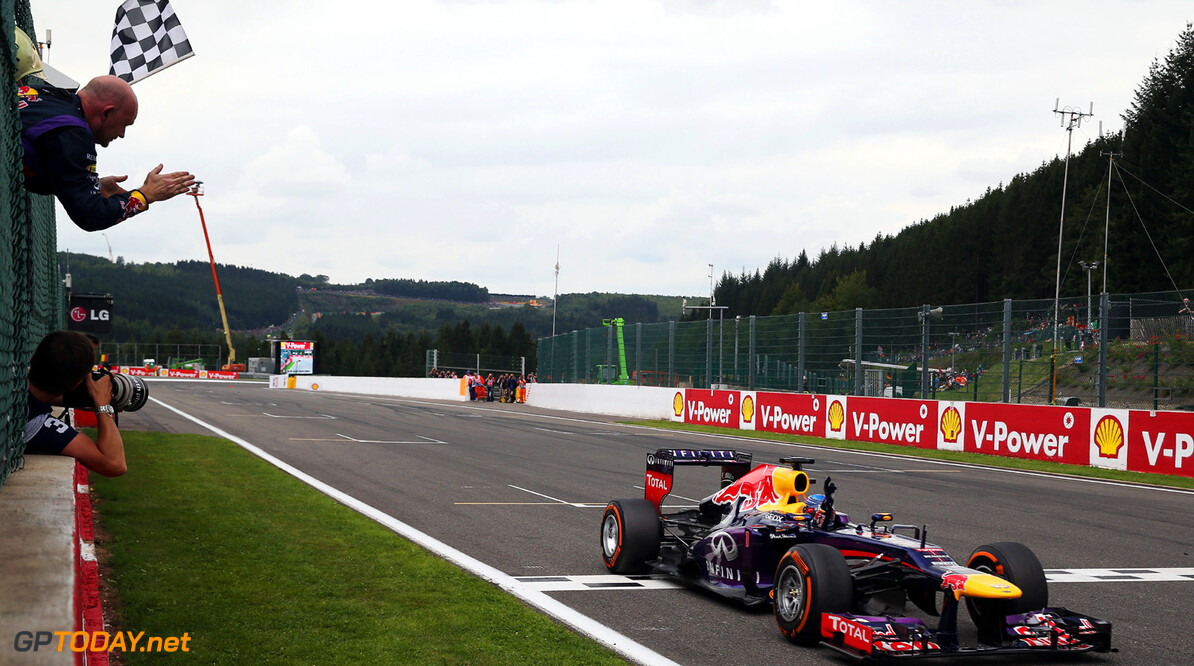 166987383KR00088_F1_Grand_P SPA, BELGIUM - AUGUST 25:  Sebastian Vettel of Germany and Infiniti Red Bull Racing celebrates as he crosses the finishing line to win the Belgian Grand Prix at Circuit de Spa-Francorchamps on August 25, 2013 in Spa, Belgium.  (Photo by Mark Thompson/Getty Images) *** Local Caption *** Sebastian Vettel F1 Grand Prix of Belgium - Race Mark Thompson Spa Belgium