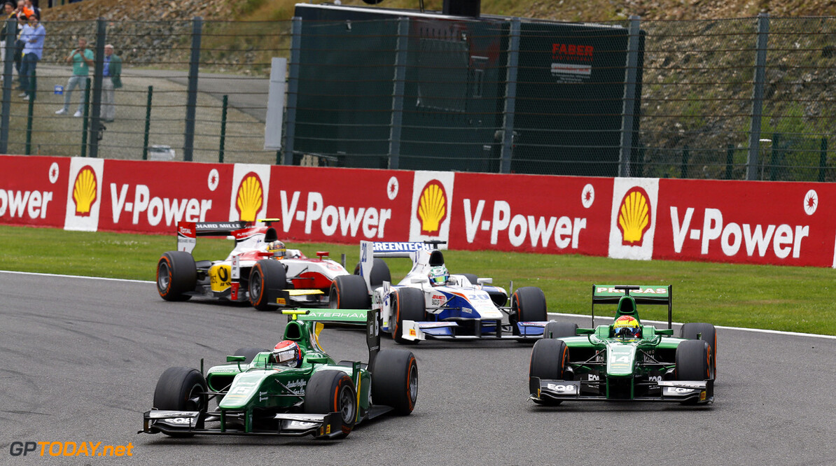 2013 GP2 Series. Round 8.  Spa - Francorchamps, Spa, Belgium. 25th August. Sunday Race. Alexander Rossi (USA, Caterham Racing) and Sergio Canamasas (ESP, Caterham Racing). Action.  World Copyright: Alastair Staley/GP2 Media Service. ref: Digital Image _R6T8733.jpg