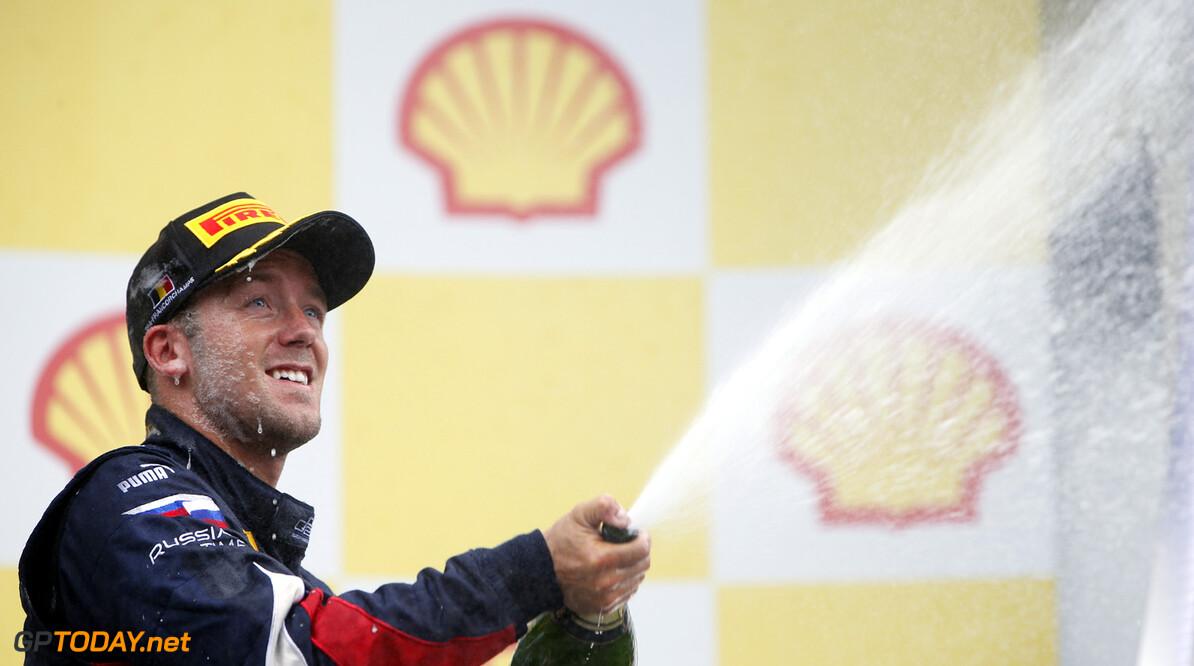 2013 GP2 Series. Round 8.  Spa - Francorchamps, Spa, Belgium. 24th August. Saturday race. Sam Bird (GBR, RUSSIAN TIME) celebrates his victory on the podium. World Copyright: Glenn Dunbar/GP2 Media Service. ref: Digital Image _89P2021.jpg