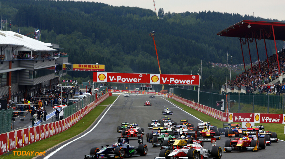 2013 GP2 Series. Round 8.  Spa - Francorchamps, Spa, Belgium. 24th August. Saturday race. Sam Bird (GBR, RUSSIAN TIME) and James Calado (GBR , ART Grand Prix) leads the field into turn on the opening lap of the race. Action.  World Copyright: Alastair Staley/GP2 Media Service. ref: Digital Image _R6T6929.jpg