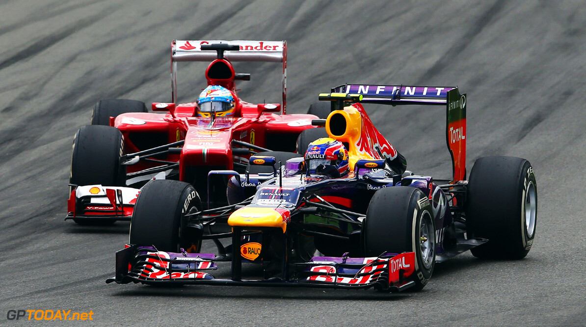 166987878GI00109_F1_Grand_P MONZA, ITALY - SEPTEMBER 08:  Mark Webber (R) of Australia and Infiniti Red Bull Racing holds off the challenge of Fernando Alonso (L) of Spain and Ferrari during the Italian Formula One Grand Prix at Autodromo di Monza on September 8, 2013 in Monza, Italy.  (Photo by Paul Gilham/Getty Images) *** Local Caption *** Mark Webber; Fernando Alonso F1 Grand Prix of Italy - Race Paul Gilham Monza Italy  SHELLGP SHELL GP