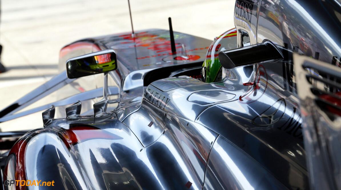 Sergio Perez prepares to leave the garage