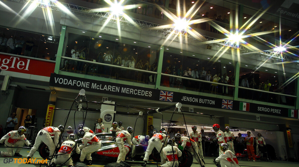 Jenson Button makes a pit stop