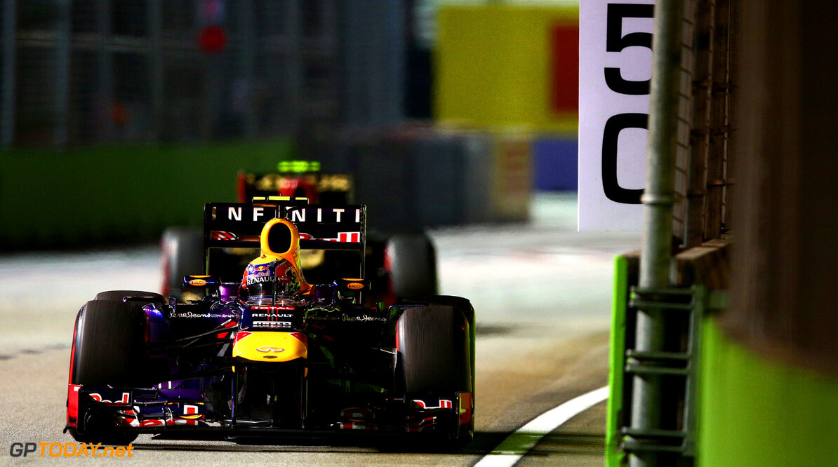 SINGAPORE - SEPTEMBER 22:  Mark Webber of Australia and Infiniti Red Bull racing drives during the Singapore Formula One Grand Prix at Marina Bay Street Circuit on September 22, 2013 in Singapore, Singapore.  (Photo by Clive Mason/Getty Images) *** Local Caption *** Mark Webber F1 Grand Prix of Singapore Clive Mason Singapore Singapore