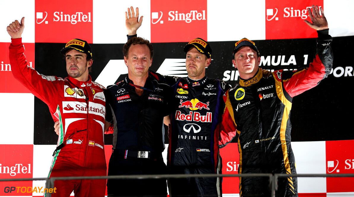 SINGAPORE - SEPTEMBER 22: (L-R) Fernando Alonso (2nd place) of Spain and Ferrari, Red Bull Racing Team Principal Christian Horner, Sebastian Vettel (1st place) of Germany and Red Bull Racing and Kimi Raikkonen (3rd place) of Finland and Lotus celebrate on the podium following the Singapore Formula One Grand Prix at Marina Bay Street Circuit on September 22, 2013 in Singapore, Singapore. *** Local Caption *** Fernando Alonso;Christian Horner;Sebastian Vettel;Kimi Raikkonen F1 Grand Prix of Singapore Mark Thompson Singapore Singapore