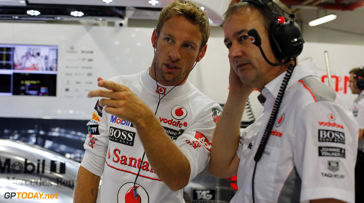 Jenson Button talks with Jonathan Neale, Managing Director in the garage.