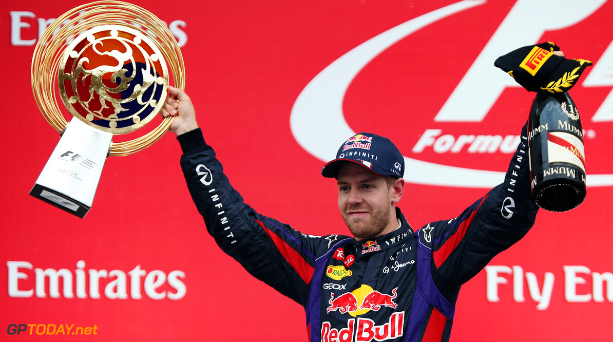 166988115KR00048_F1_Grand_P YEONGAM-GUN, SOUTH KOREA - OCTOBER 06:  Sebastian Vettel of Germany and Infiniti Red Bull Racing celebrates on the podium after winning the Korean Formula One Grand Prix at Korea International Circuit on October 6, 2013 in Yeongam-gun, South Korea.  (Photo by Mark Thompson/Getty Images) *** Local Caption *** Sebastian Vettel F1 Grand Prix of Korea - Race Mark Thompson Yeongam-gun South Korea  F1 Mokpo
