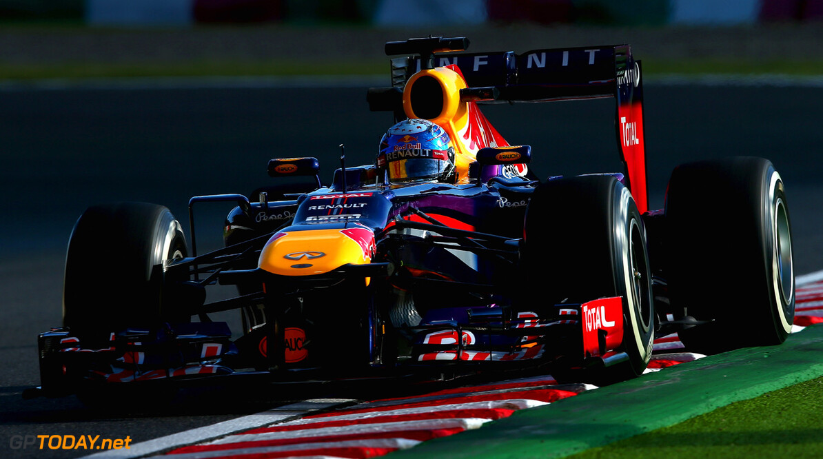 166988151KR00214_F1_Grand_P SUZUKA, JAPAN - OCTOBER 11:  Sebastian Vettel of Germany and Infiniti Red Bull Racing drives during practice for the Japanese Formula One Grand Prix at Suzuka Circuit on October 11, 2013 in Suzuka, Japan.  (Photo by Clive Mason/Getty Images,) *** Local Caption *** Sebastian Vettel F1 Grand Prix of Japan - Practice Clive Mason Suzuka Japan