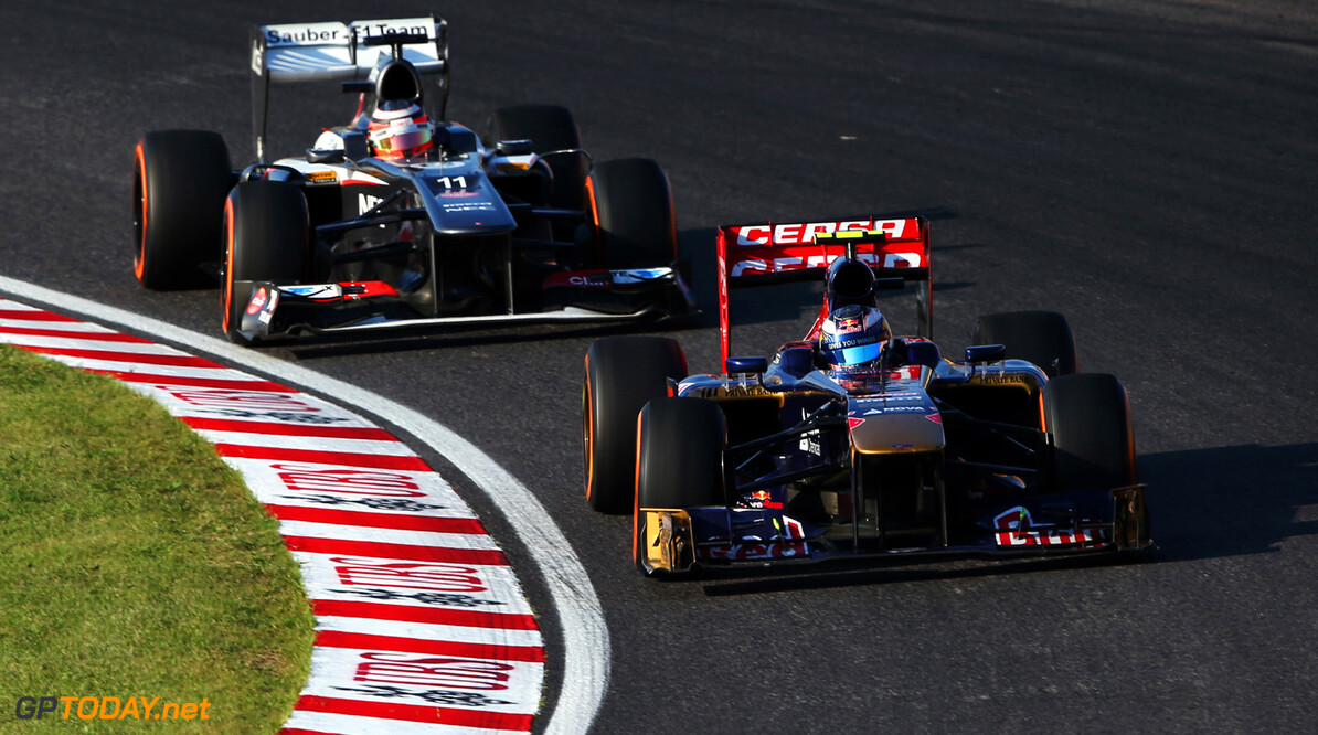 166988186KR00241_F1_Grand_P SUZUKA, JAPAN - OCTOBER 13:  Daniel Ricciardo of Australia and Scuderia Toro Rosso drives during the Japanese Formula One Grand Prix at Suzuka Circuit on October 13, 2013 in Suzuka, Japan.  (Photo by Mark Thompson/Getty Images) *** Local Caption *** Daniel Ricciardo F1 Grand Prix of Japan - Race Mark Thompson Suzuka Japan