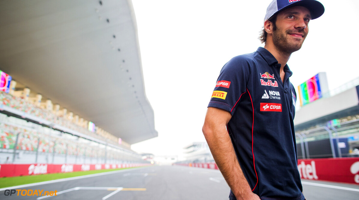 166988224XX00163_F1_Grand_P NOIDA, INDIA - OCTOBER 24:  Jean-Eric Vergne of France and Scuderia Toro Rosso is interviewed on the grid during previews for the Indian Formula One Grand Prix at Buddh International Circuit on October 24, 2013 in Noida, India.  (Photo by Peter Fox/Getty Images,) *** Local Caption *** Jean-Eric Vergne F1 Grand Prix of India -  Previews Peter Fox Noida India  Delhi F1 Formula One Grand Prix