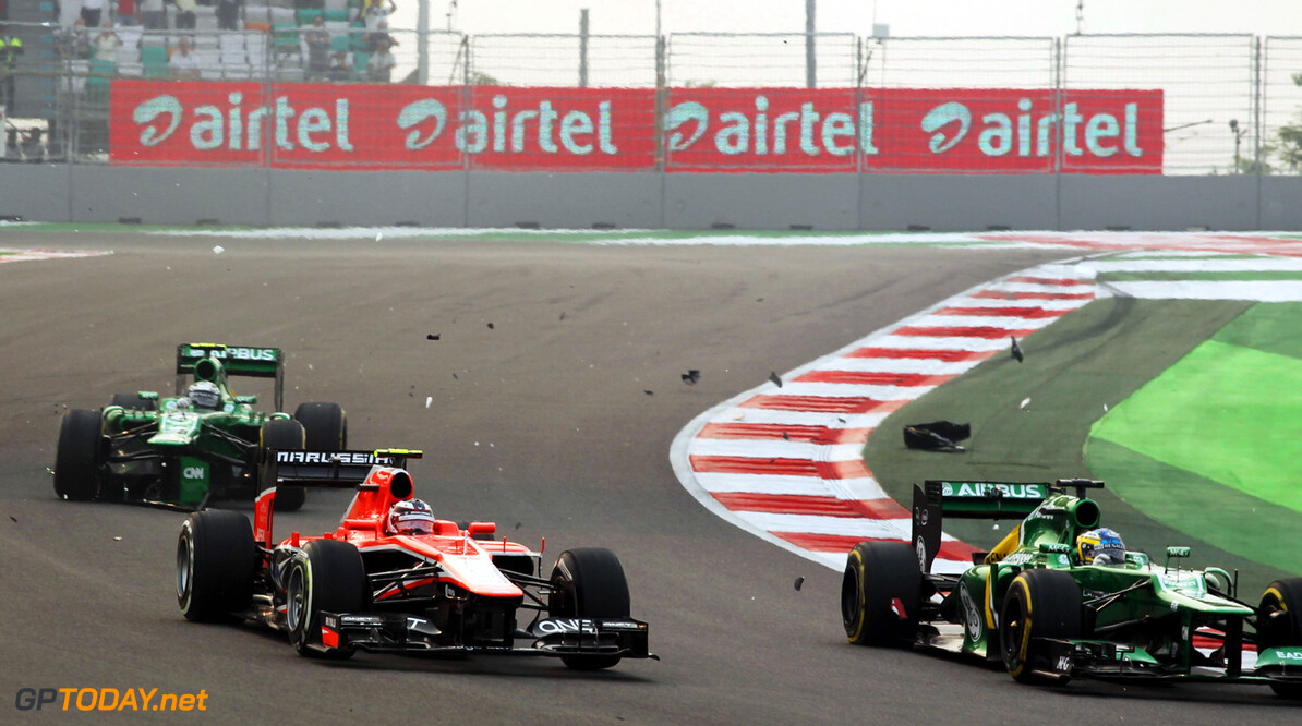 Formula One World Championship Charles Pic (FRA) Caterham CT03, Max Chilton (GBR) Marussia F1 Team MR02 and Giedo van der Garde (NLD) Caterham CT03 involved in contact at the start of the race.  27.10.2013. Formula 1 World Championship, Rd 16, Indian Grand Prix, New Delhi, India, Race Day. Motor Racing - Formula One World Championship - Indian Grand Prix - Race Day - New Delhi, India Marussia F1 Team New Delhi India  Formel1 Formel F1 Formula 1 Formula1 GP Grand Prix one Buddh International Circuit October Noida Greater Noida Uttar Pradesh Sunday 27 27 10 10 2013 Action Track