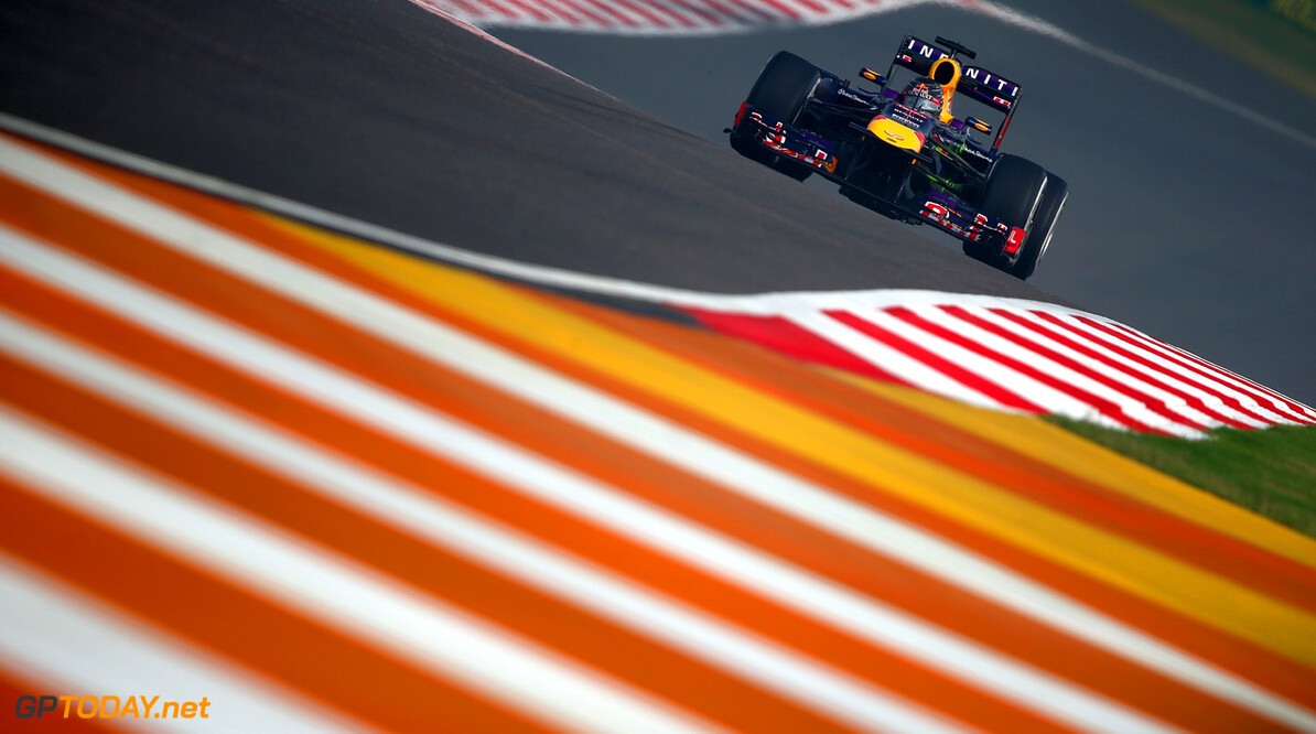 166989242XX00036_F1_Grand_P NOIDA, INDIA - OCTOBER 25:  Sebastian Vettel of Germany and Infiniti Red Bull Racing drives during practice  for the Indian Formula One Grand Prix at Buddh International Circuit on October 25, 2013 in Noida, India.  (Photo by Clive Mason/Getty Images) *** Local Caption *** Sebastian Vettel F1 Grand Prix of India - Practice Clive Mason Noida India  Delhi