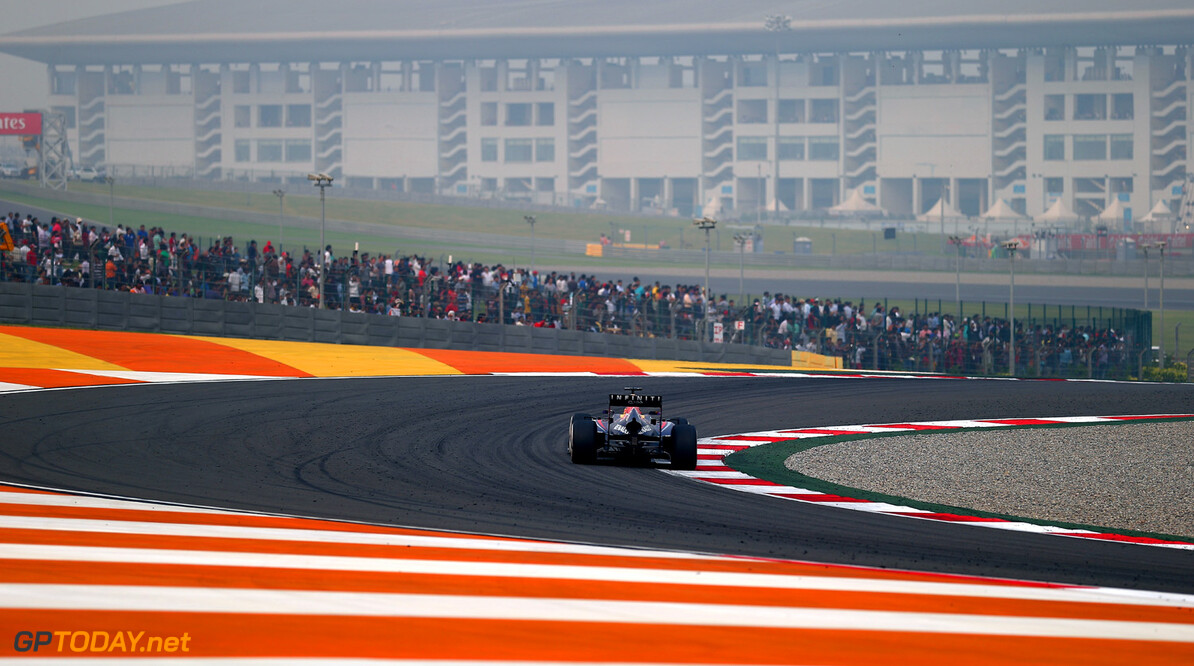 166989286XX00266_F1_Grand_P NOIDA, INDIA - OCTOBER 27:  Sebastian Vettel of Germany and Infiniti Red Bull Racing drives on his way to winning the Indian Formula One Grand Prix at Buddh International Circuit on October 27, 2013 in Noida, India.  (Photo by Clive Mason/Getty Images) *** Local Caption *** Sebastian Vettel F1 Grand Prix of India - Race Clive Mason Noida India  Delhi