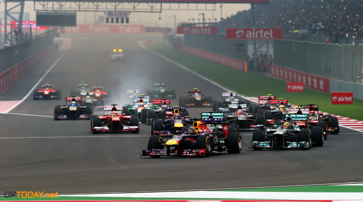 166989286XX00018_F1_Grand_P NOIDA, INDIA - OCTOBER 27:  Sebastian Vettel of Germany and Infiniti Red Bull Racing leads the field into the first corner at the start of the Indian Formula One Grand Prix at Buddh International Circuit on October 27, 2013 in Noida, India.  (Photo by Mark Thompson/Getty Images) *** Local Caption *** Sebastian Vettel F1 Grand Prix of India - Race Mark Thompson Noida India  Delhi