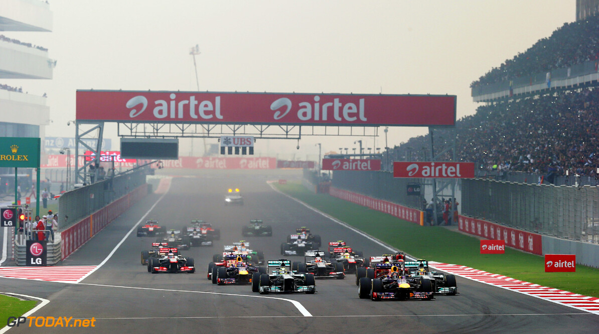 166989286XX00021_F1_Grand_P NOIDA, INDIA - OCTOBER 27:  Sebastian Vettel of Germany and Infiniti Red Bull Racing leads the field into the first corner at the start of the Indian Formula One Grand Prix at Buddh International Circuit on October 27, 2013 in Noida, India.  (Photo by Mark Thompson/Getty Images) *** Local Caption *** Sebastian Vettel F1 Grand Prix of India - Race Mark Thompson Noida India  Delhi