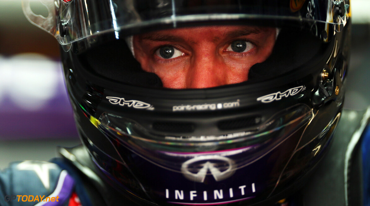 166989242XX00005_F1_Grand_P NOIDA, INDIA - OCTOBER 25:  Sebastian Vettel of Germany and Infiniti Red Bull Racing prepares to drive during practice  for the Indian Formula One Grand Prix at Buddh International Circuit on October 25, 2013 in Noida, India.  (Photo by Mark Thompson/Getty Images) *** Local Caption *** Sebastian Vettel F1 Grand Prix of India - Practice Mark Thompson Noida India  Delhi